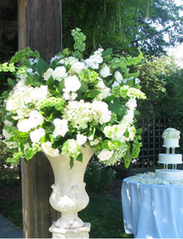 6. Garden wedding flowers in tall white sculpture