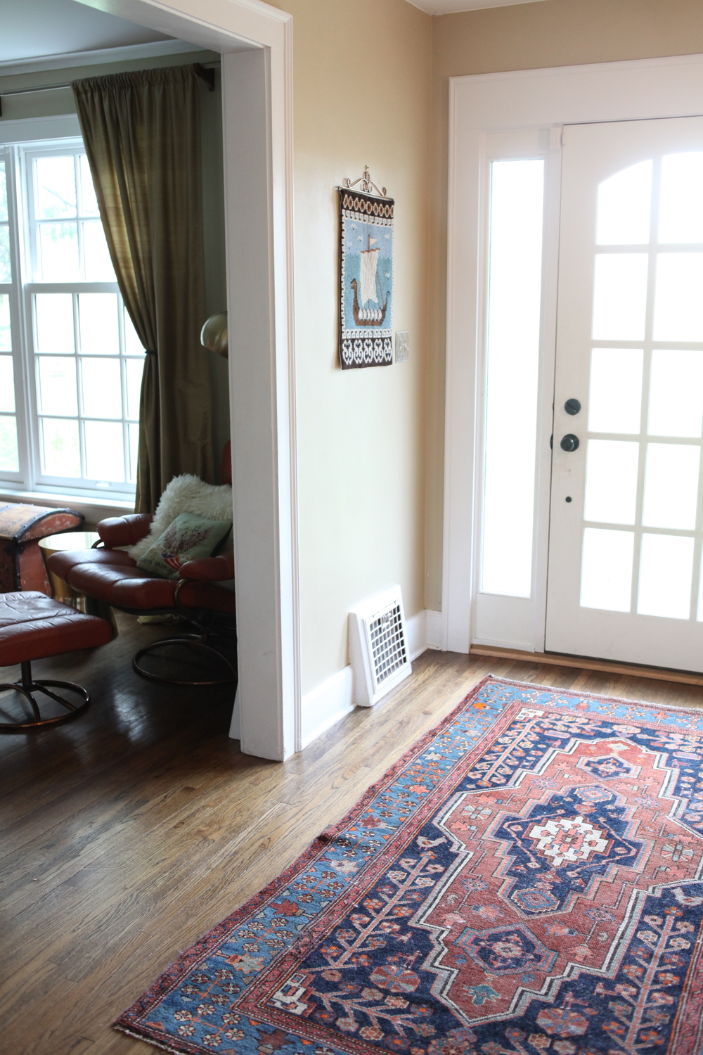 Modern Scandinavian Foyer with Persian rug and needlepoint
