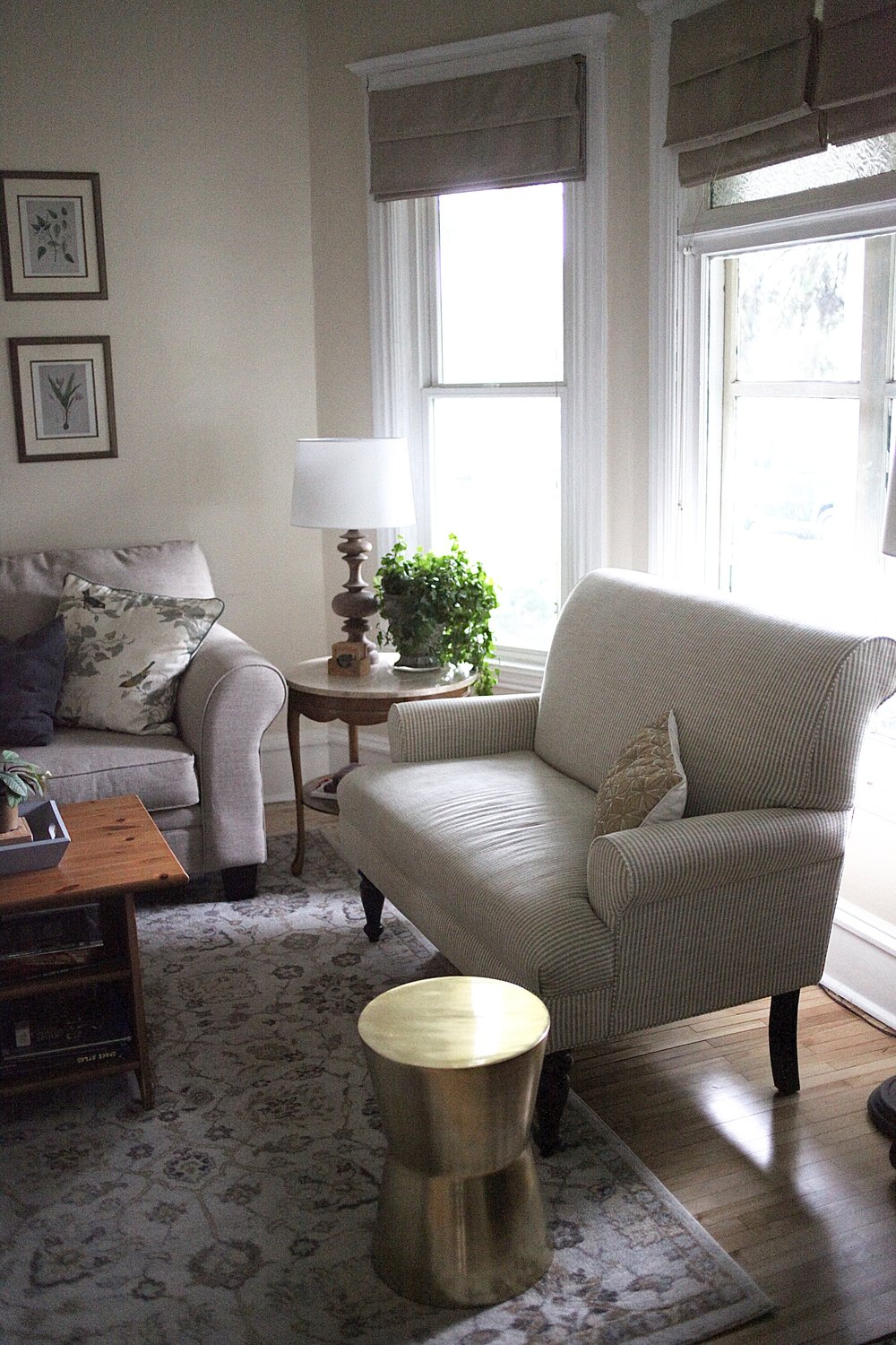Cozy Living Room with neutral settee and modern brass side table