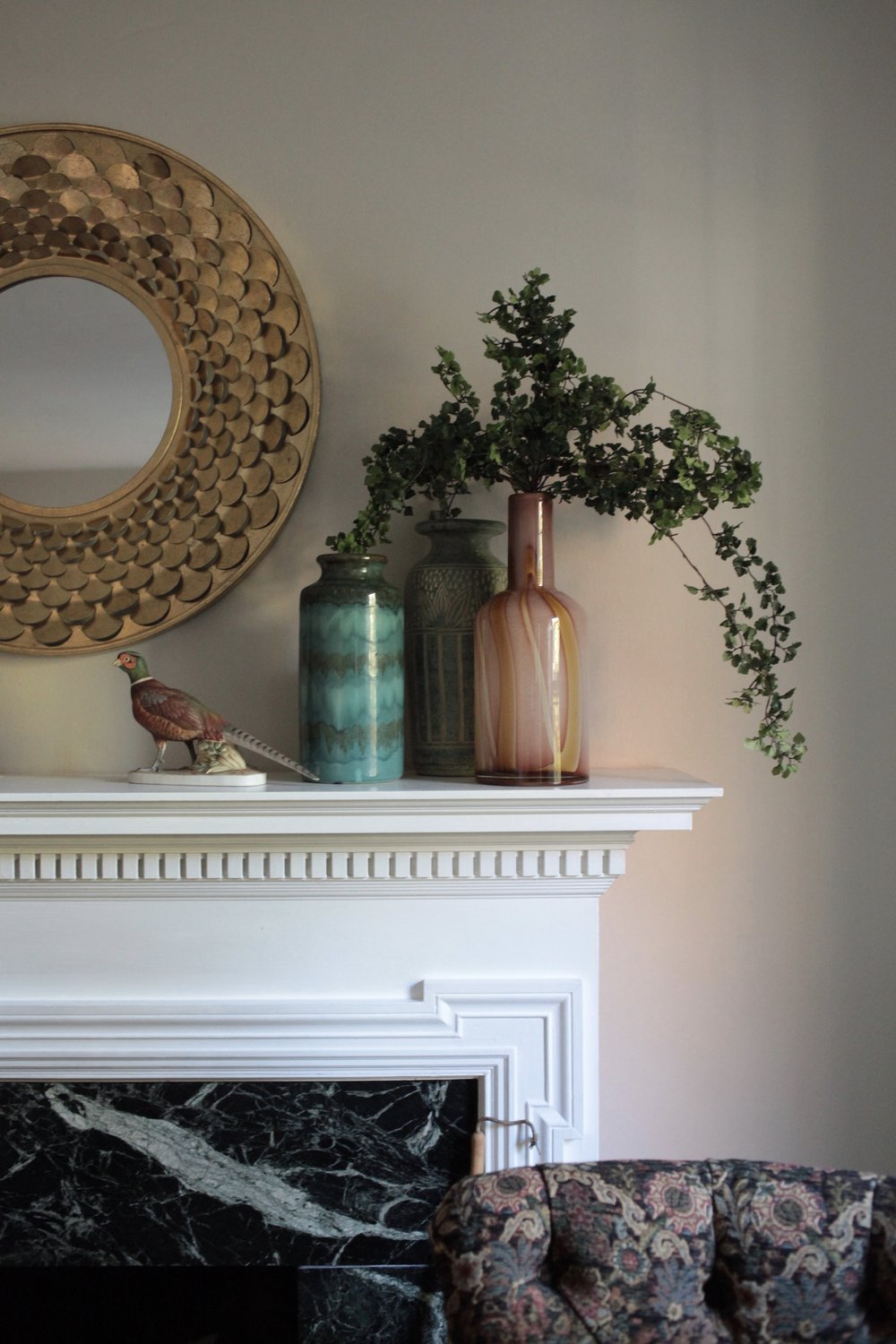 Gold round mirror and styled vases