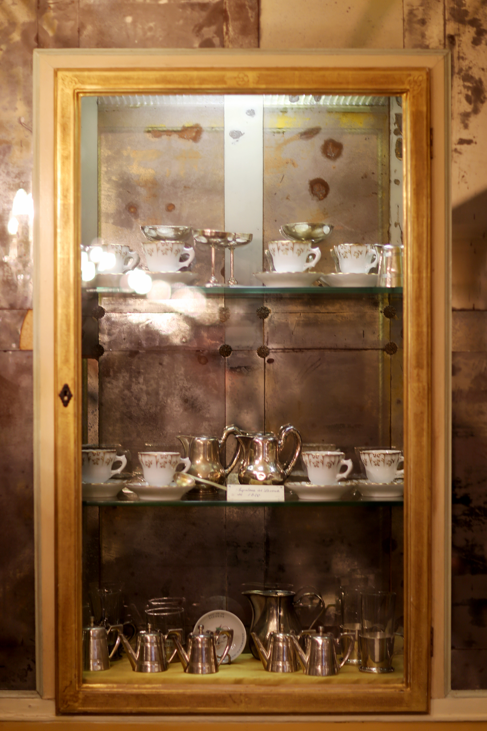 A display of a china and silver sets from circa 1800