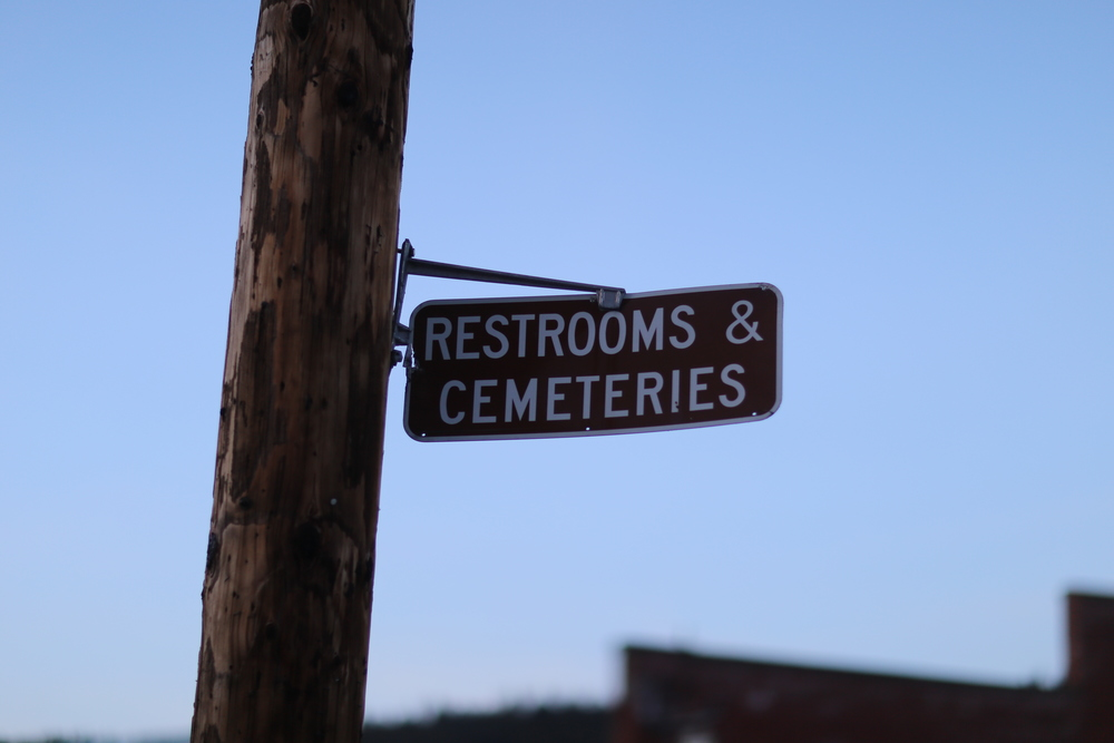 """Restrooms & Cemeteries"" Sign, Roslyn"