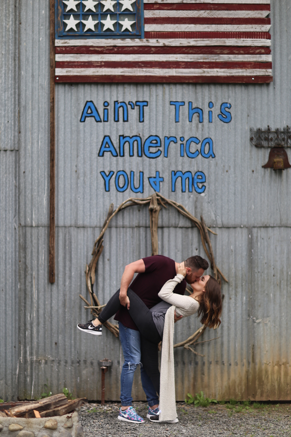 """Ian and Sarah Nelson kiss before Klennert's """"Ain't This America, You & Me"""" piece"""
