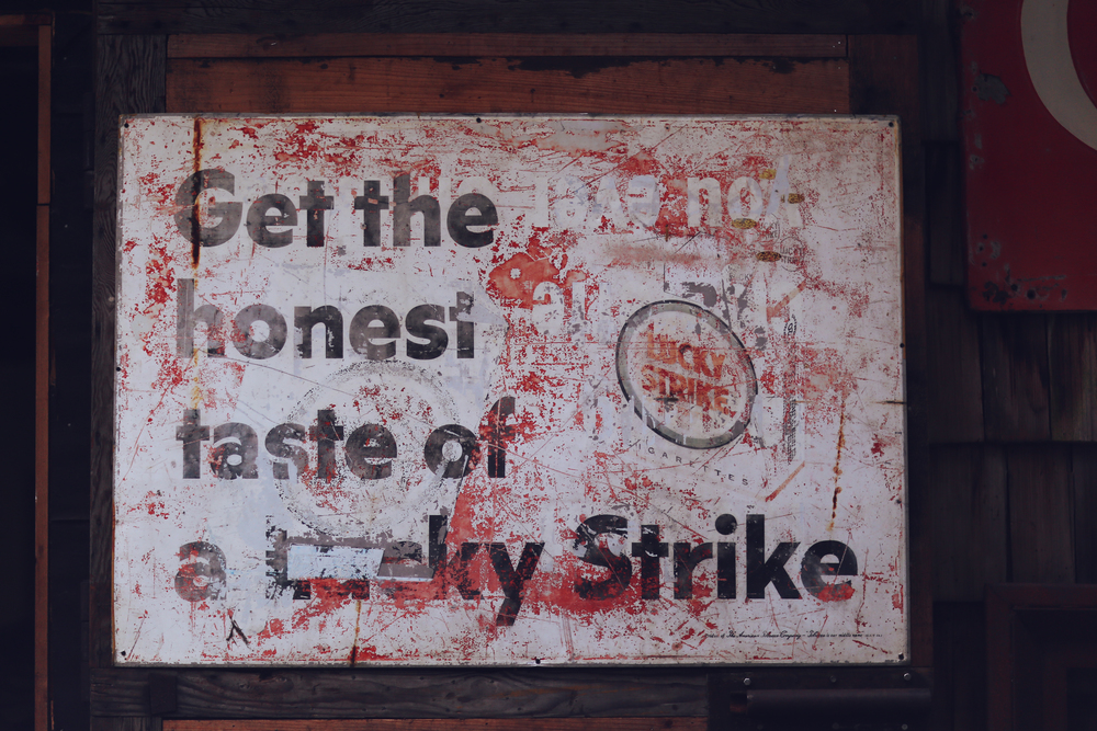 Decaying Lucky Strike sign
