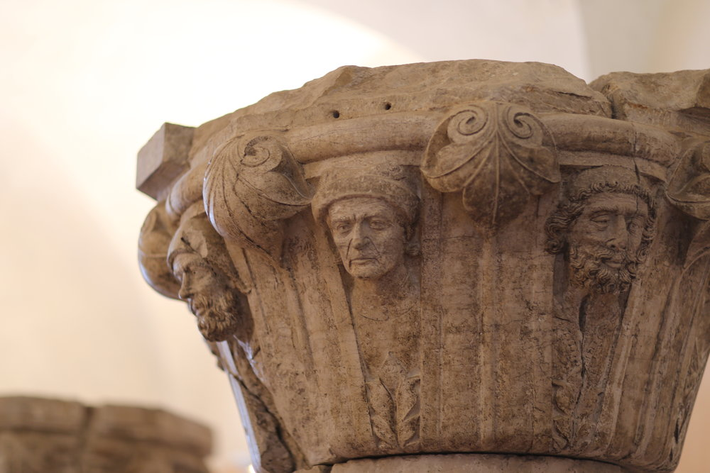 Original column capitals at the Palazzo Ducale