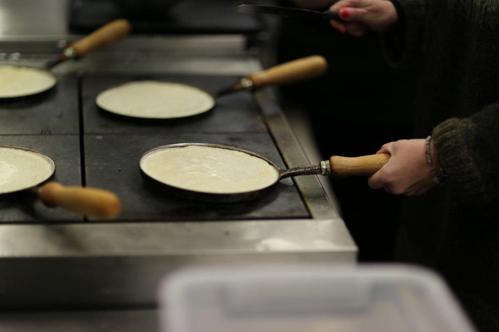 Sigrun G Bates making pancakes