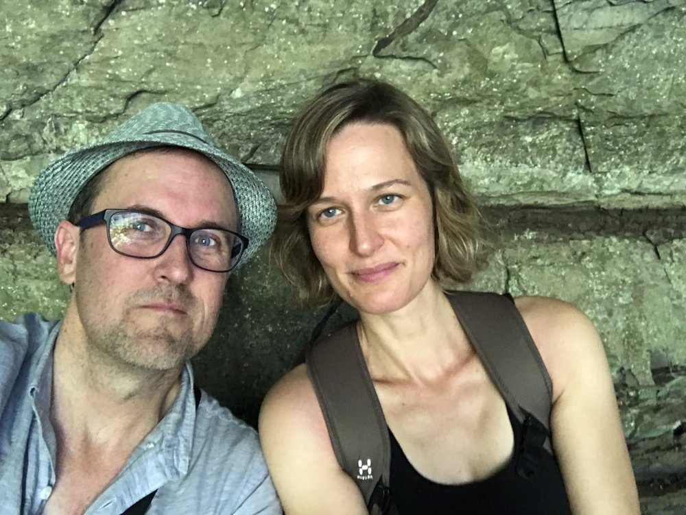Selfie of me and Elaine Schimek very warm at the end of our hike, here walking behind North Falls