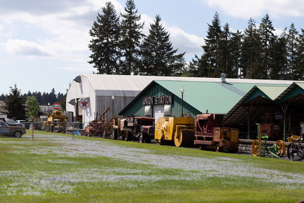 Vintage farm equipment, plus a view of some of the Marymount buildings