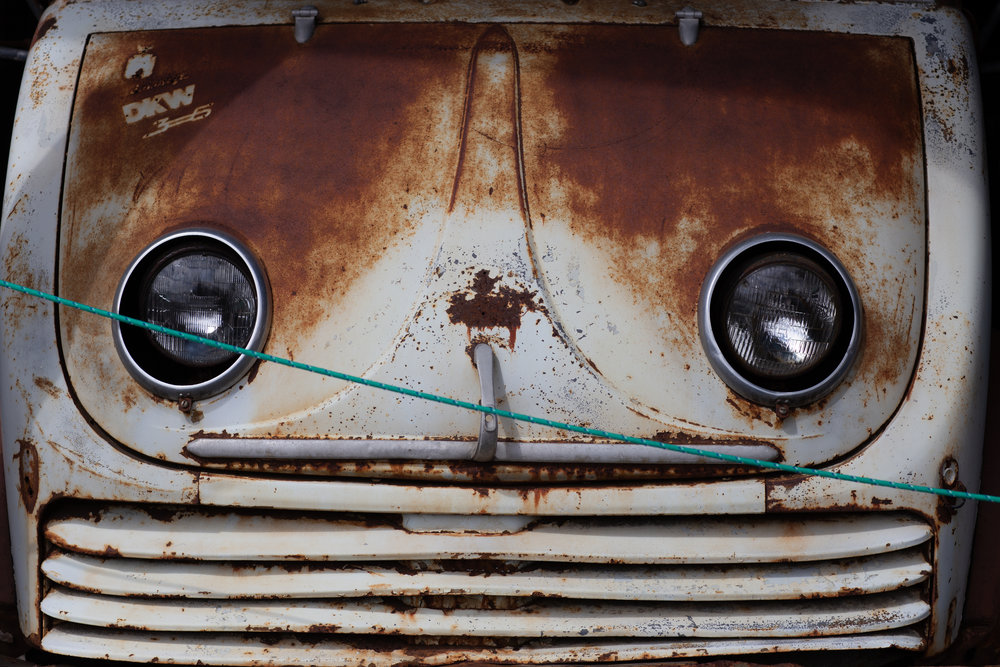 Front of a vintage, well-loved van