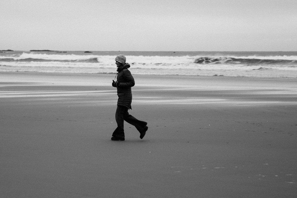 Elaine Schimek enjoying the freedom of running on the beach