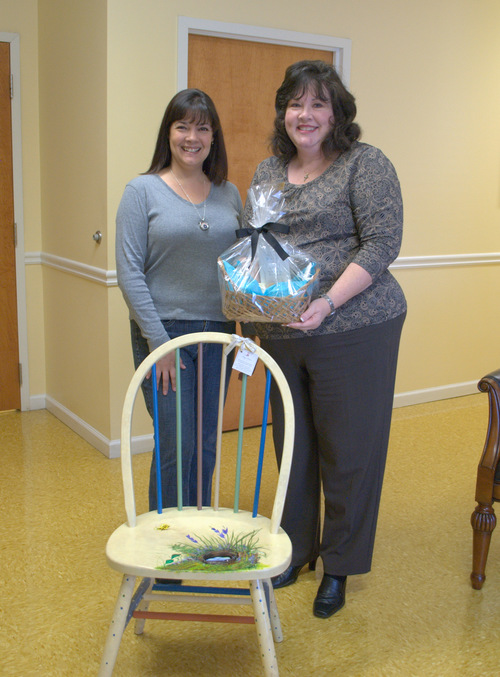 Maggie Miller donating one of her hand painted chairs along with a bath & body gift basket from her bath collection.