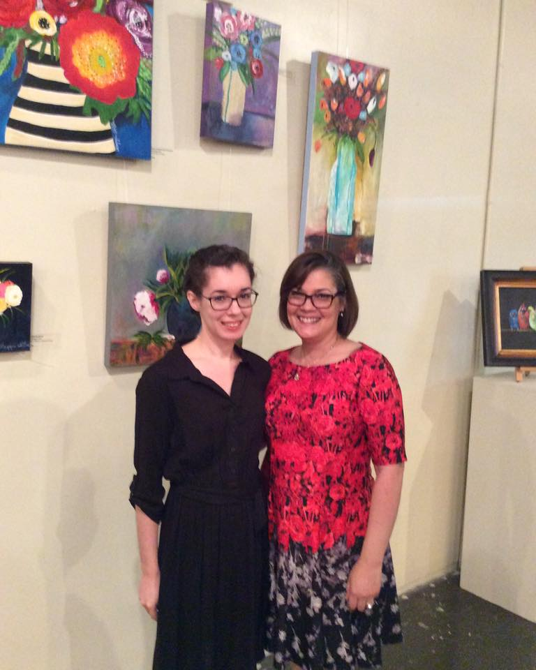 My daughter and me by my paintings at The Hood Street Center