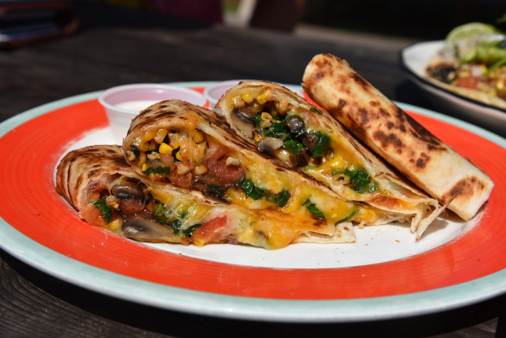 """Bartlett Farm Quesadilla""   Stuffed with spinach, mushrooms, roasted eggplant, tomato, sweet corn, salad and jack & cheddar cheese."