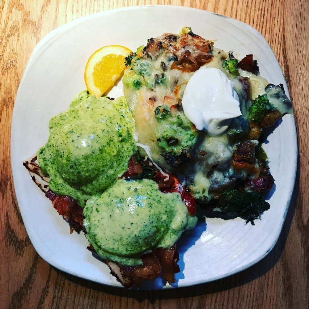 """""""Bene Du Jour"""" - fancy for pesto eggs Benedict (with a side of veggie home fries).    Courtesy of Fog Island Cafe"""