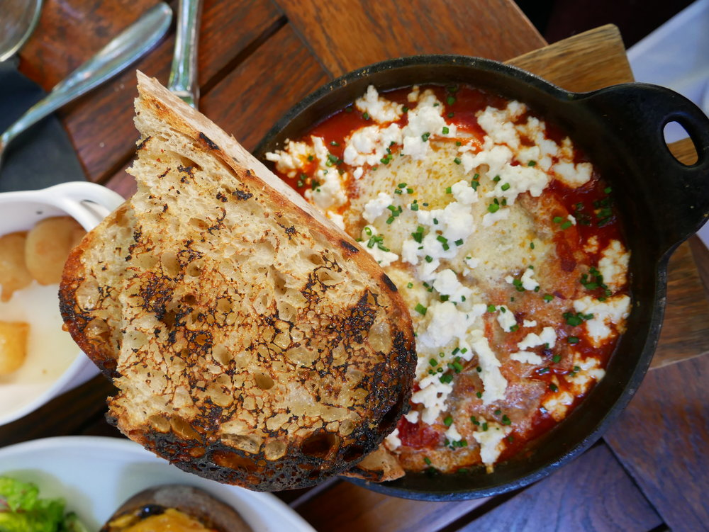 Baked hen eggs, roasted chili pomodoro, crumbled feta and sourdough