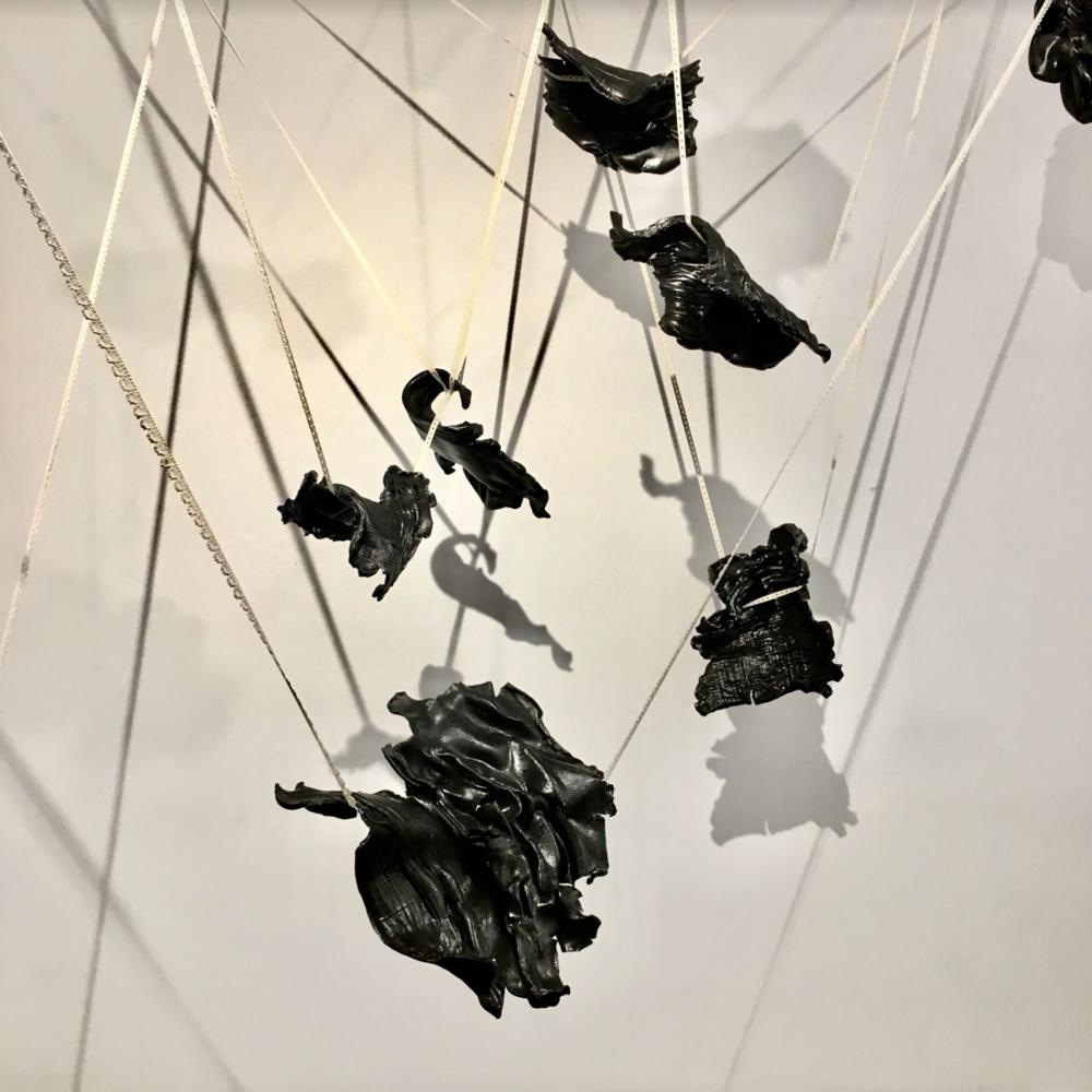 Trajectory.  Stoneware, black terra sigillata, lace. Installation approx. 12'L x 7'W x 9'H