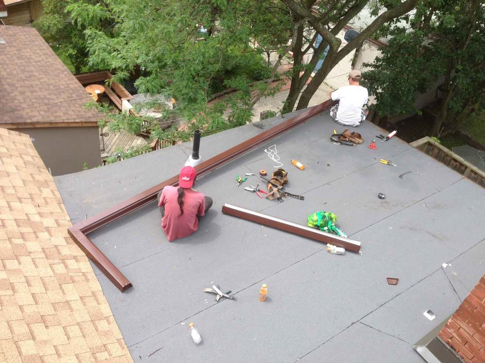 Rear flat roof is done and the rear shingled slope and the new eaves troughs are going in.