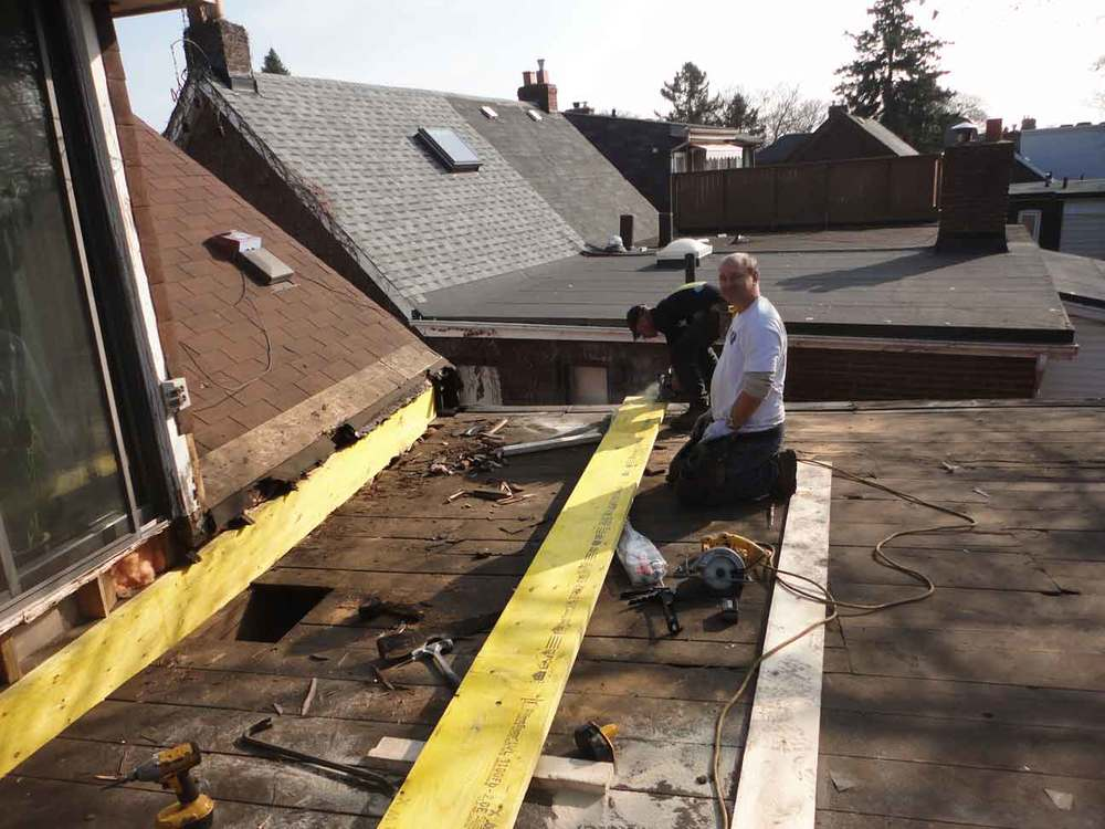 Removed two of the rotted beams and installing stronger ones (glued together etc..).
