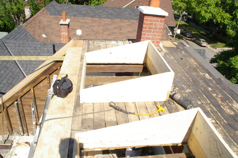 Chimney rebuilt now. Two skylights are starting to be framed in.