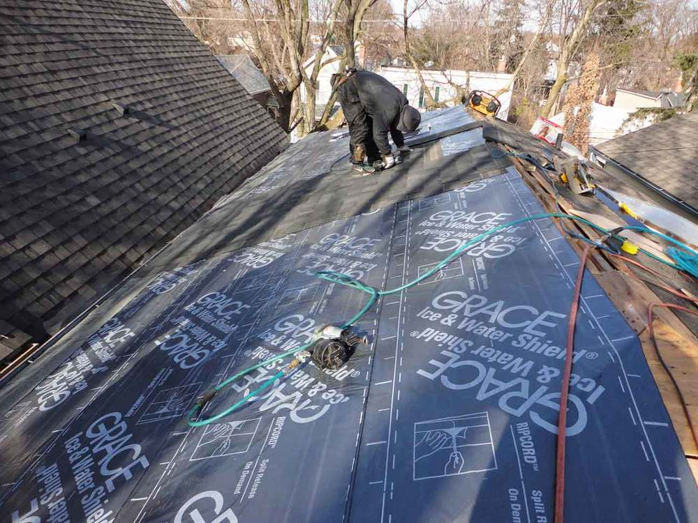 Roofing is being installed as we go so nothing is left open to the elements for too long. Note the fully waterproof layer the shingles are being applied over.  The shingles are a  Limited Lifetime  one. They last about 30 years from what I see once properly installed.