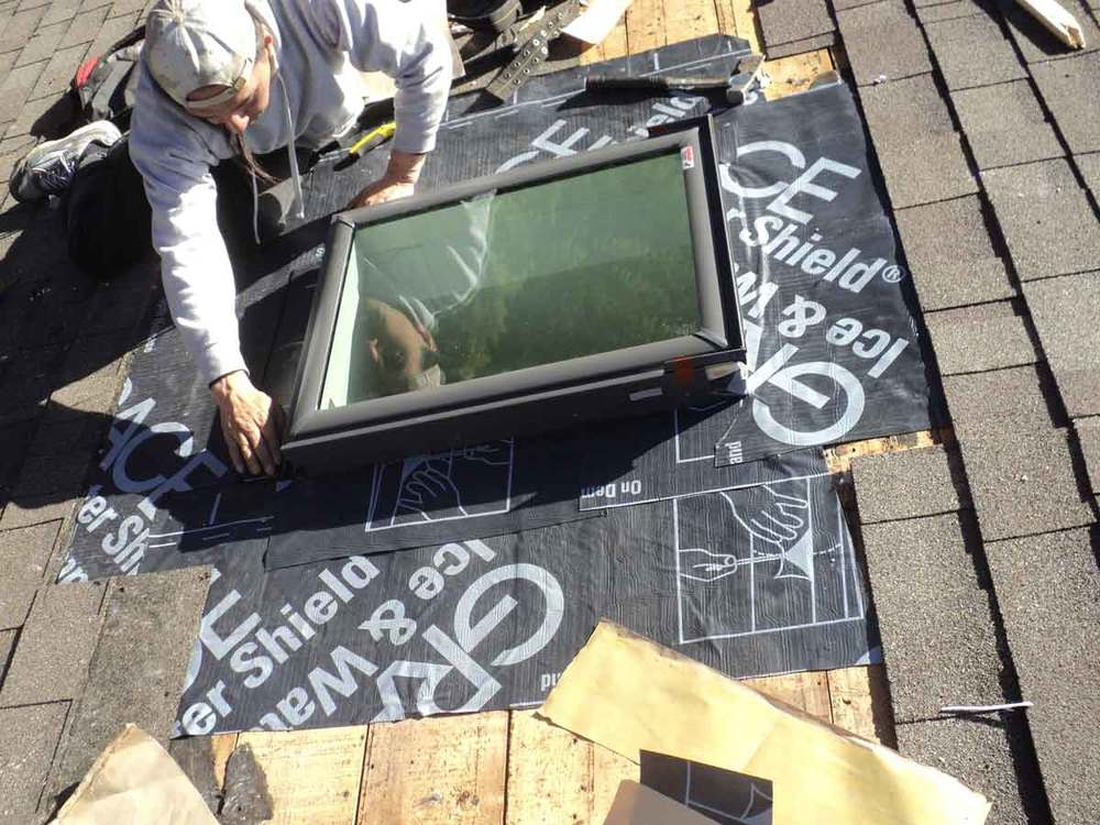 New skylight installed. Rubber membrane fully around it onto the lower shingles.