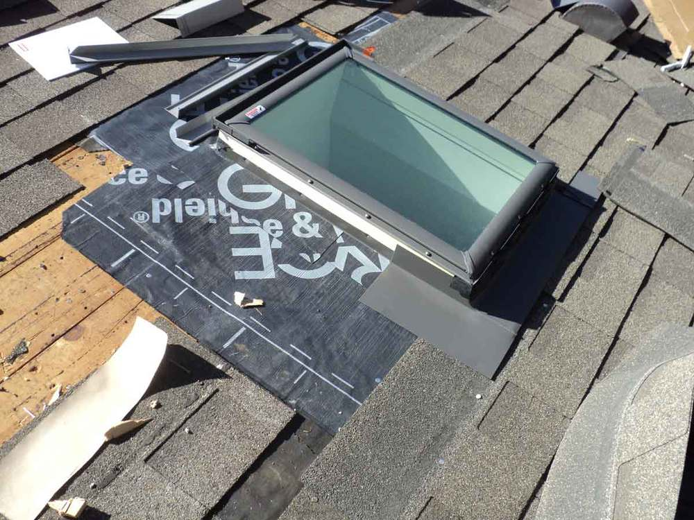 New metal (flashing) being installed at the bottom.