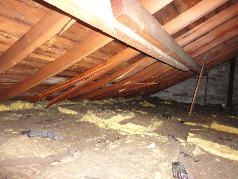 Inspection: inside attic reveals that beams/structure are snapping. Insulation is good.