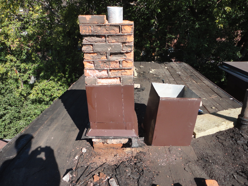 Exisitng chimney had been covered in brown metal which I had guessed meant it was rotten. This turned out to be true. Chimney was rebuilt.