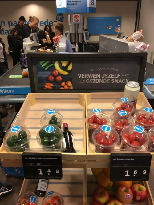 "Picture 5. Nudging shoppers to choose a healthier snack at checkout. The display reads, ""Healthy To Go: Treat Yourself to a Healthy Snack."""
