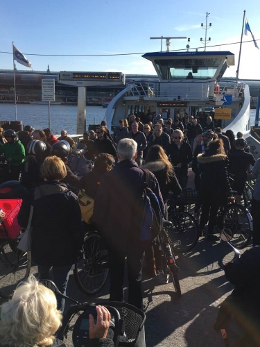 Picture 1. Boarding passengers creep towards the center of the ferry platform.