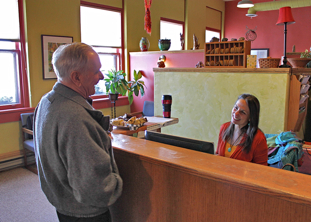 MARVIN and Patti share a laugh at the front desk.
