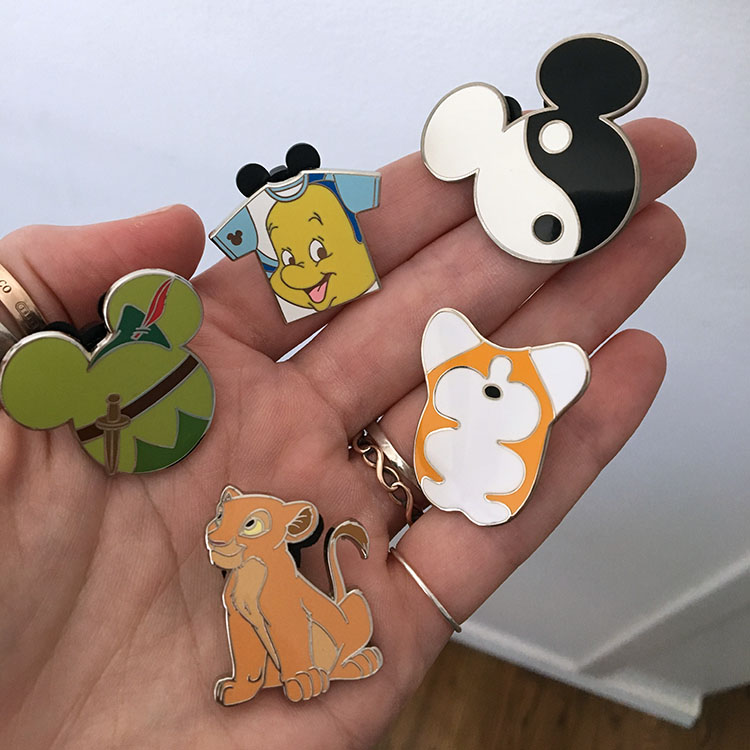 My Disney pins + my corgi pin for le animalé! I love small awesomeness.
