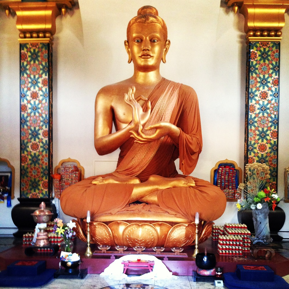 Buddha statue inside  The Great Stupa of Dharmakaya at  Shambhala Mountain Center in Red Feather Lakes, Colorado. Photo by Linda Arcuri.