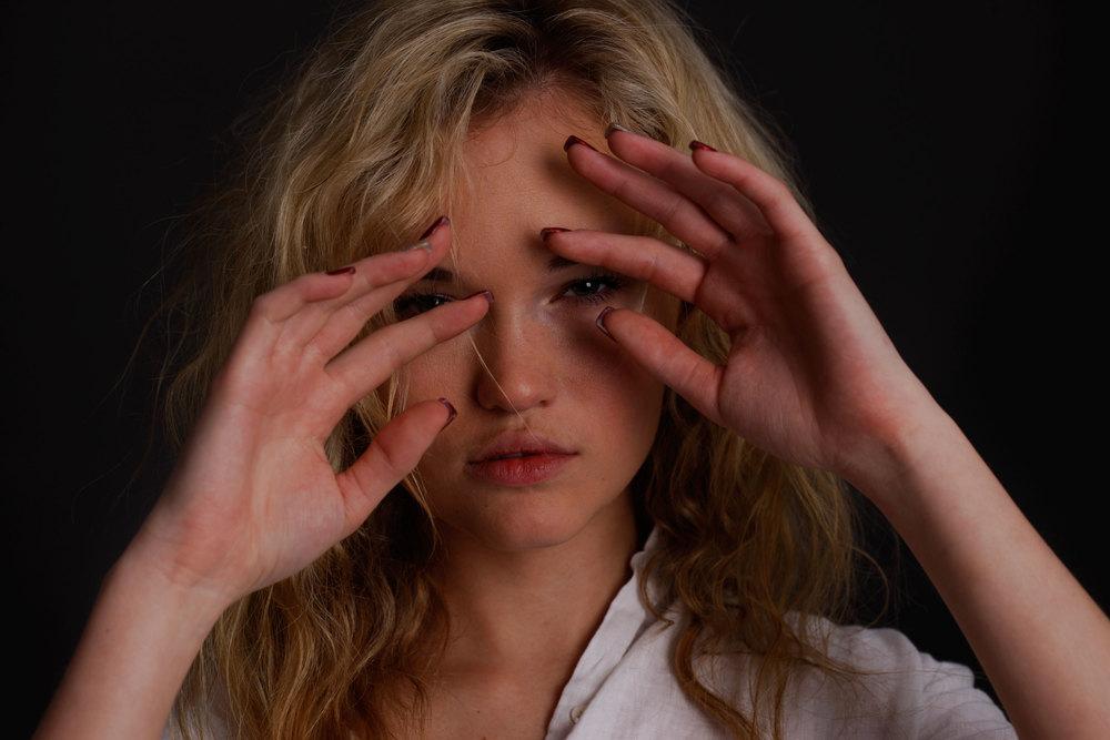 Blonde-hands-face.jpg