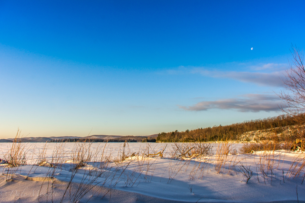 A cold 15 degree F winters day with the moon in the upper right corner of the photo.