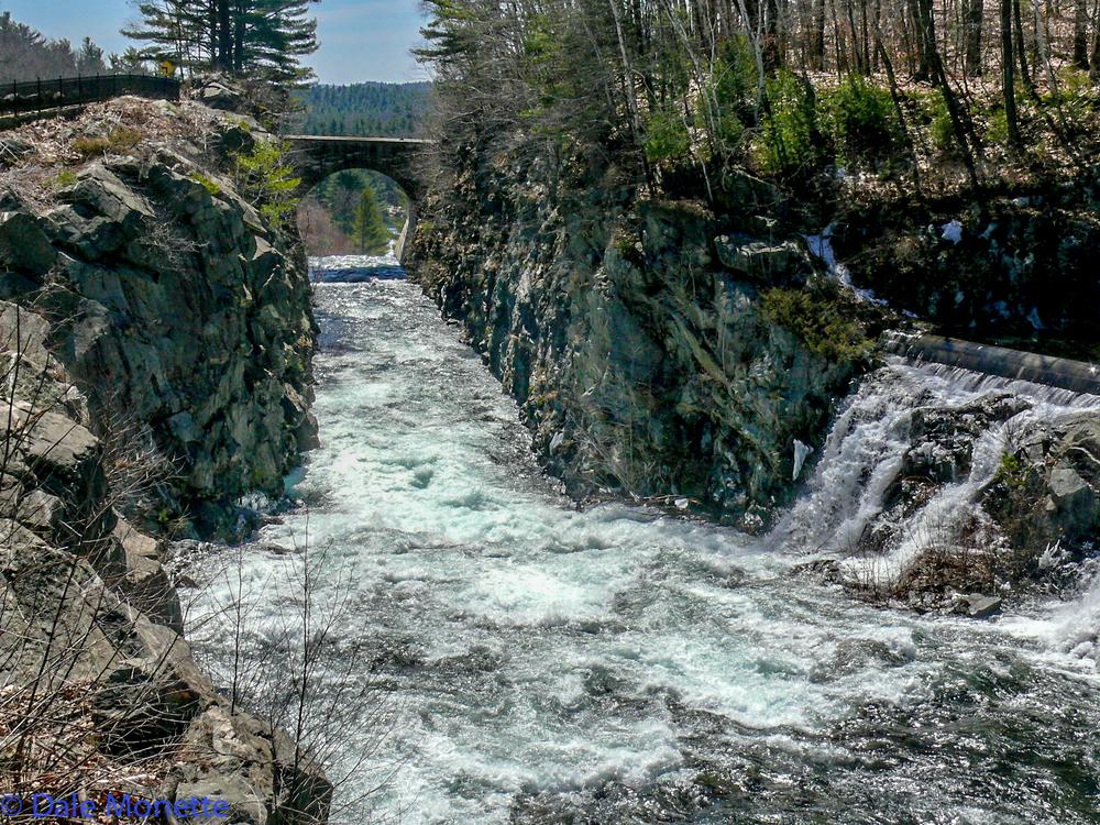 It follows a sluiceway after it flows over a 400 foot long dam.