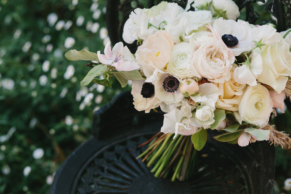 Kym's Bridal bouquet included anemone, rose, poppy, sweet pea, ranunculi, reed grasses and fruiting quince blossom.