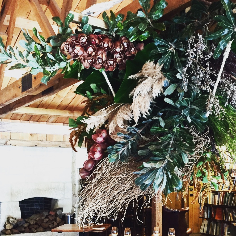 This in the only photo, a little crudely taken by me and my IPhone but the only one of the reception ceiling floral, so heavily textural and such a beautiful rich palette. Cymbidium orchid, reed grass, banksia foliage, amaranthys, philodendron leaves and dried date palm.