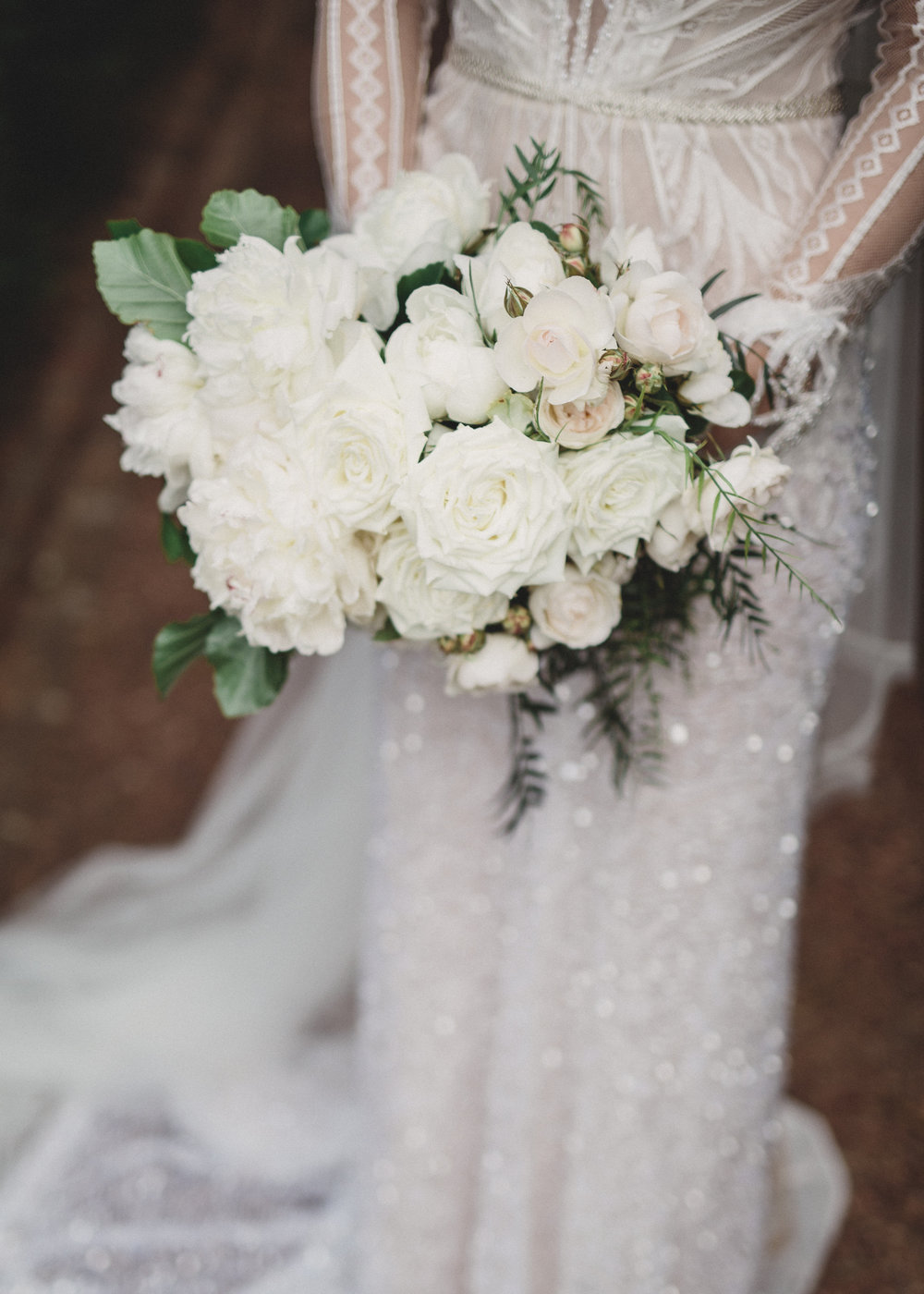 Zoe's bouquet was made up of fully blown white garden roses and peony, green beech and peppercorn arranged into a luxe garden inspired unstructured bouquet.