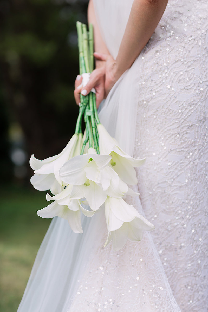 Elegant repetition of longi lillies and a perfume that will always be remembered. Photography by Milenko Weddings.