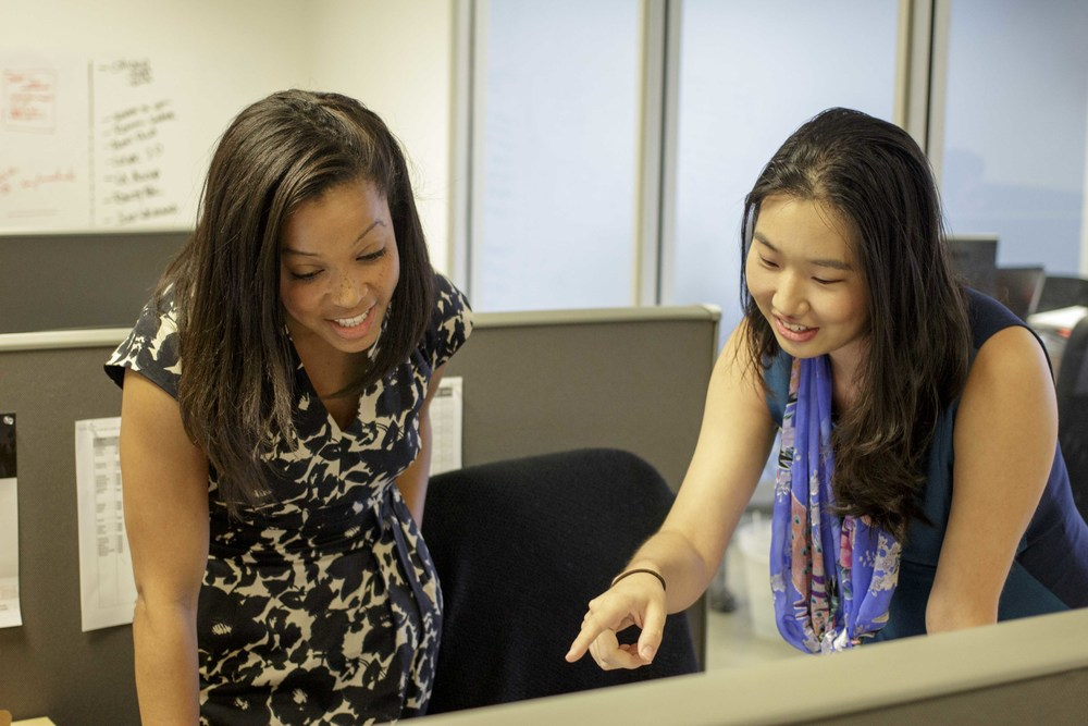 Amy and Corporate Counsel, Mera Baker (L), look over documents for Patch of Land at their Los Angeles office.