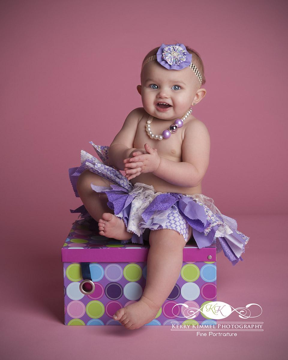 Such a doll in her purple tutu!