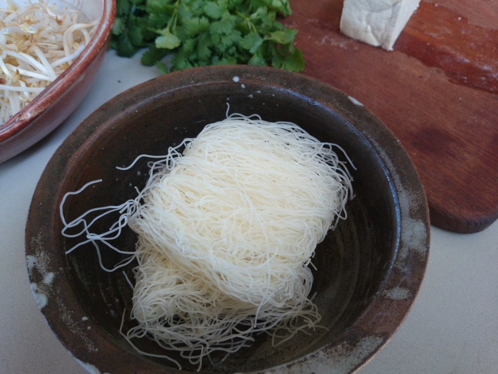 Brittle rice noodles tend to zing around the kitchen.