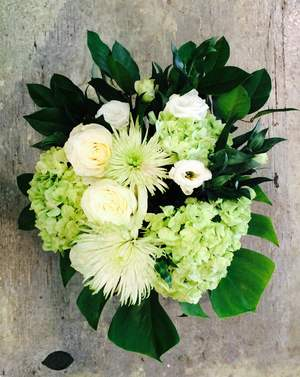 Greens and whites floral arrangment
