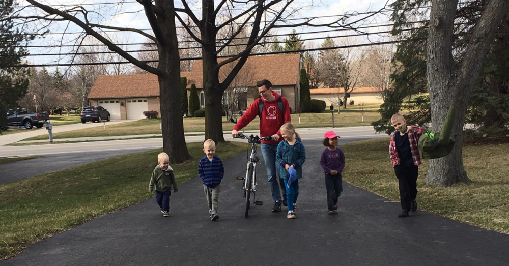 The kids excited to see Justin home from working at the library.