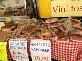 Buy prosciutto at local markets on my Tuscan food tour
