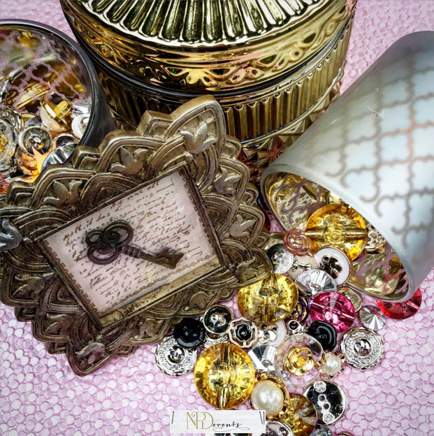A few of our favorite embellishments . Candles, buttons, small frames, tea lights and a very blush pink runner.