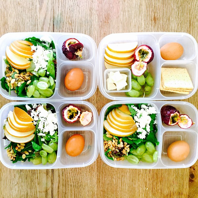 My 8 year old designed this lunch for her first day of school. So proud of her, we hunted the farmers market together for the best arugula and passion fruit. I am going to miss having my girls home.  For the big #kidslunch we have arugula and red lettuce salad with Asian pear, grapes, pepitas and goat cheese. Passion fruit and hard boiled eggs. For the #toddlerlunch we did goat Gouda and crackers instead of salad. #lunch #preschoollunch #glutenfree #vegetarian #feedfeed