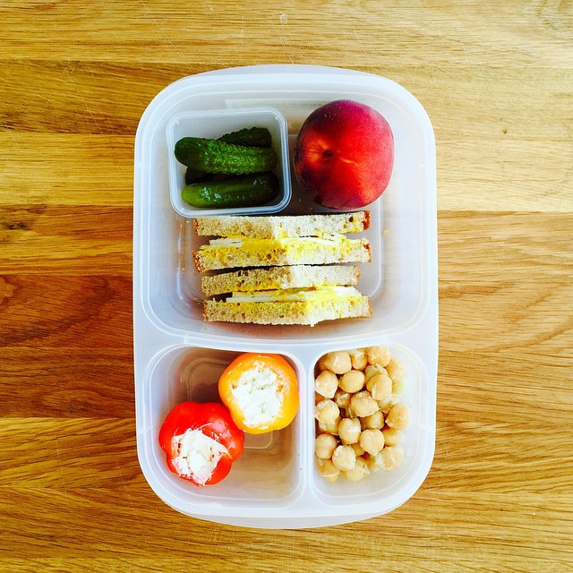 Another lunch that my 8year old designed...she is so inspired after summer break! Classic @applegate turkey sandwich, pickles, lemony chickpeas, the most perfect high desert peach and goat cheese stuffed peppers (her new favorite). #kidslunch #lunch #rockthelunchbox