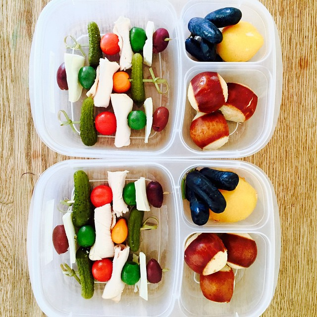 Lunch on a stick for the #toddlerlunch today!  Olives, pickles, tomato, goat Gouda and turkey with tiny pretzel bread, yellow Italian plums and the most delicious Moon Drop Grapes. Some of the grapes were as long as fingers! @graperygrapes #lunch #preschoollunch #kidslunch #kidslunchideas #bentobox #easylunchboxes #feedfeed